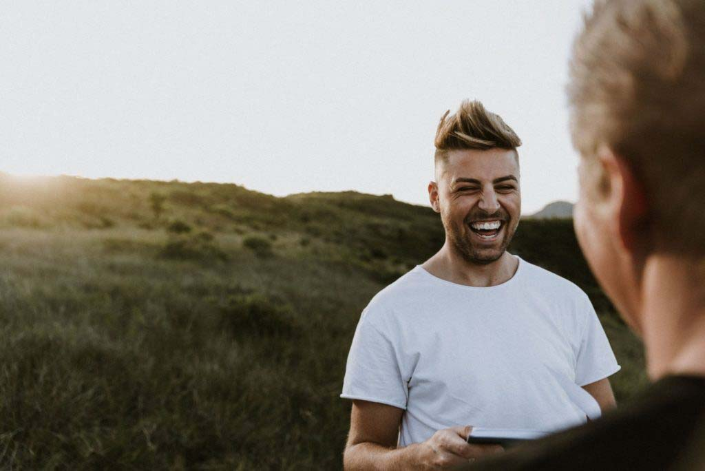same sex pre-wedding photoshoot in national park as two grooms stare into each others eyes