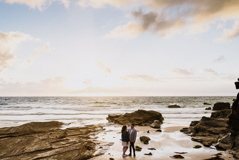 top engagement photoshoot location bride and groom kissing in amazing sunrise on beach