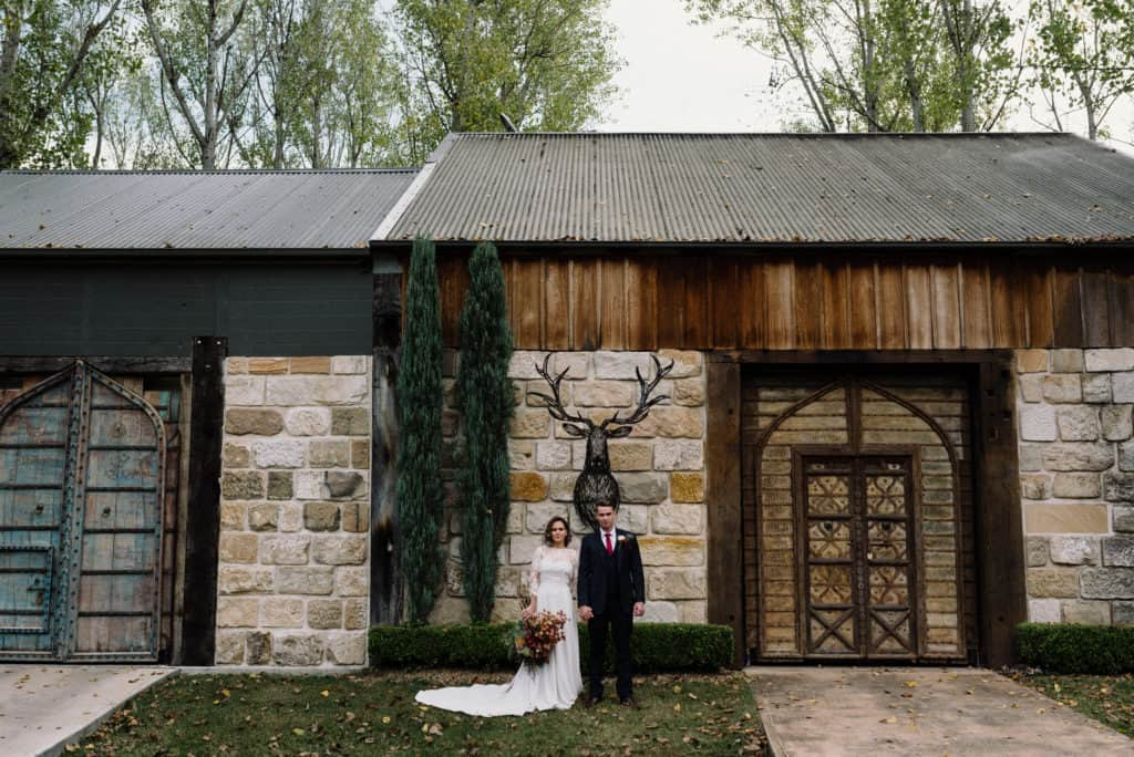 bride and groom out the front of rustic barn at stonehurst wedding hunter valley