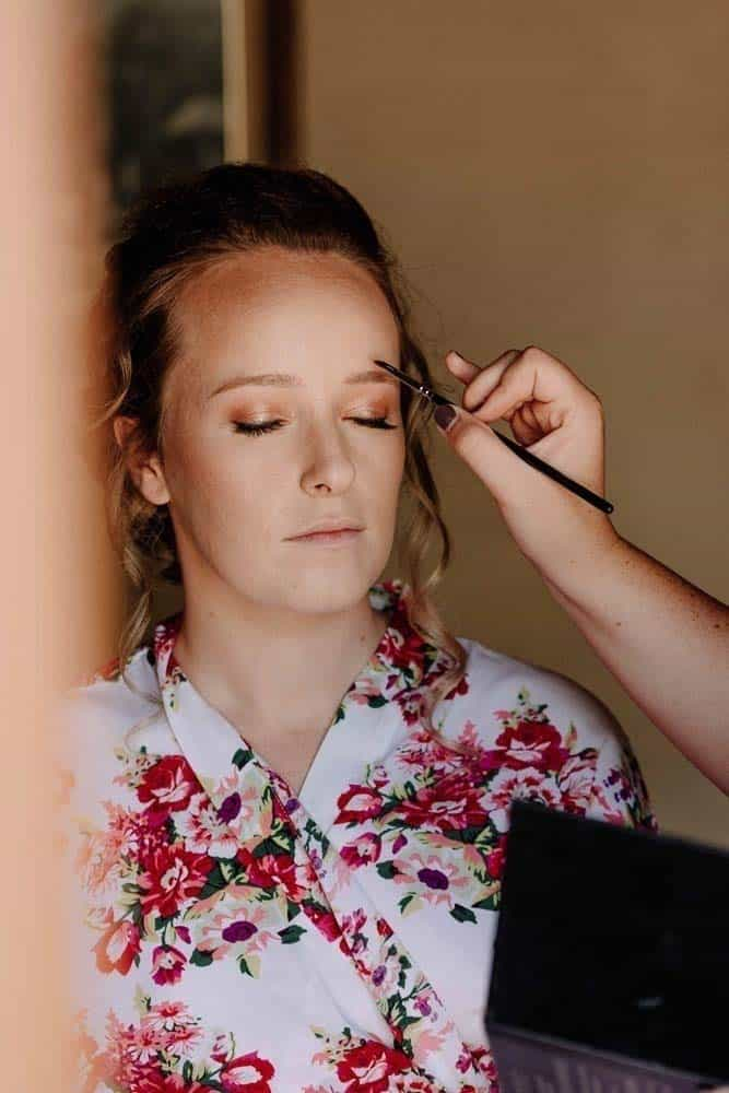 beautiful bride gets makeup done in cottage pre wedding captured by James White Hunter Valley Wedding Photographer