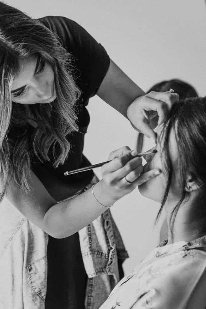 Bride getting makeup finished before wedding ceremony captured by hunter valley wedding photographer james white