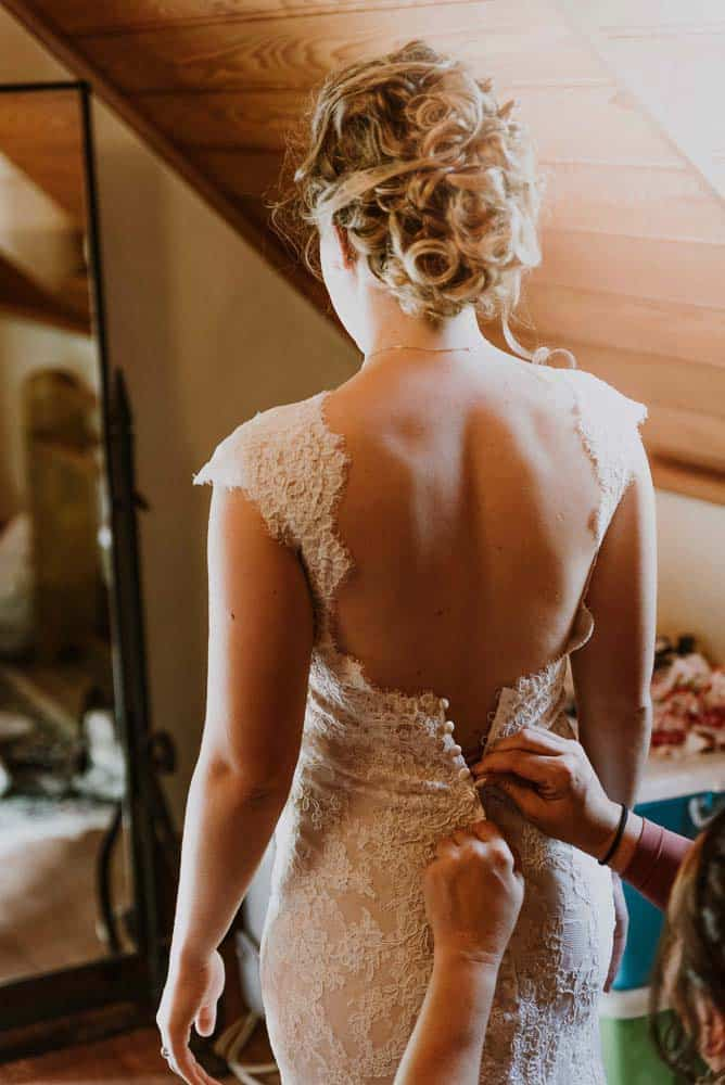 bride stares into beautiful mirror captured by james white hunter valley wedding photographer