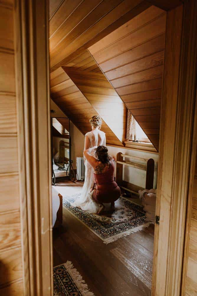 gorgeous bride stands in cottage gazing at mirror captured by james white hunter valley wedding photographer