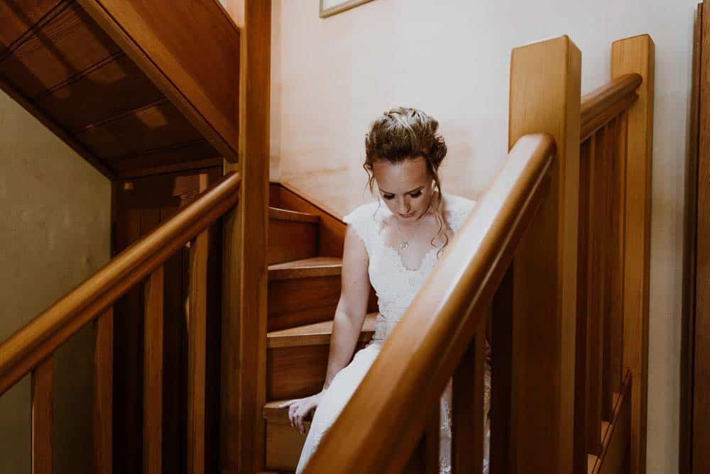 dazzling bride sitting on stairs captured by james white hunter valley wedding photographer