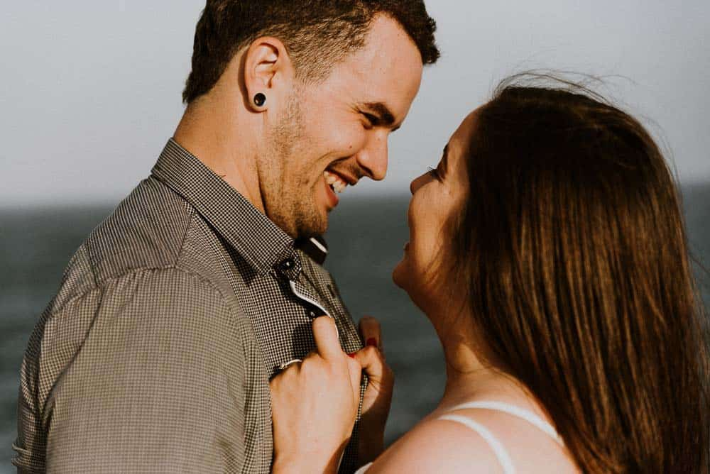side on close up of bride and groom laughing in the sun captured by james white hunter valley wedding photographer
