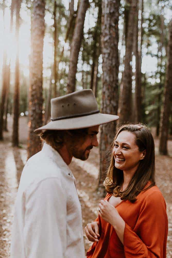 bride and groom being silly in forest captured by james white hunter valley wedding photographer