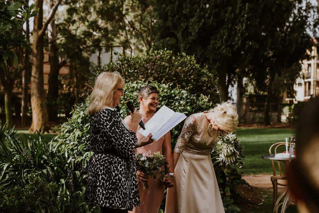 bride laughs during wedding ceremony captured by james white hunter valley wedding photographer