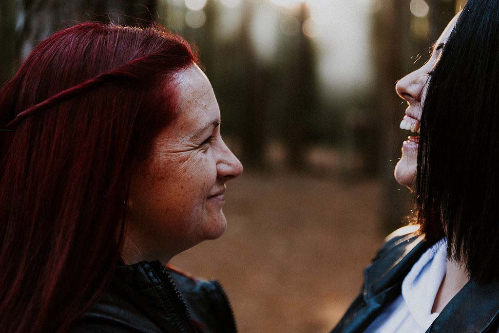 bride laughs as her wife to be smiles captured by james white hunter valley wedding photographer