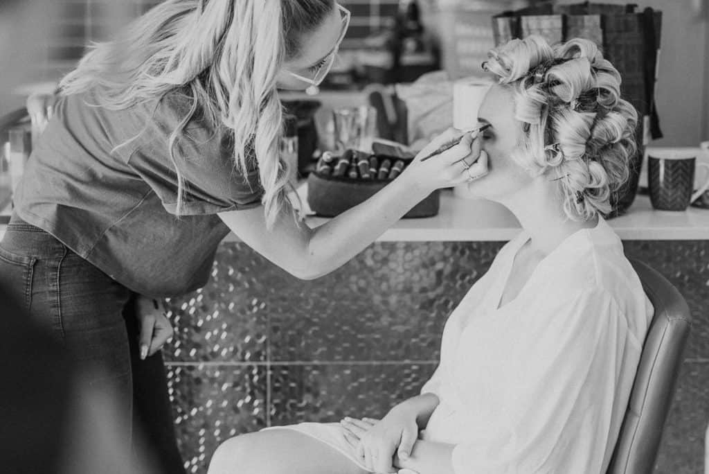 Brooke Brianna finishing brides makeup before wedding captured by candid hunter valley wedding photographer James White