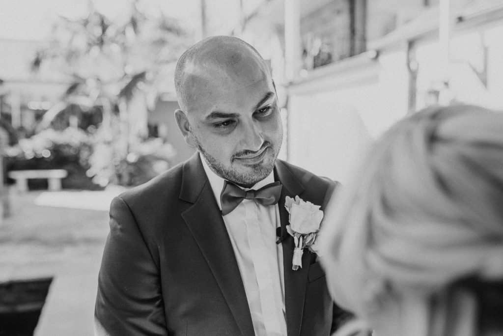 Groom sheds a tear during first look with bride. Candid shot captured by hunter valley wedding photographer james white