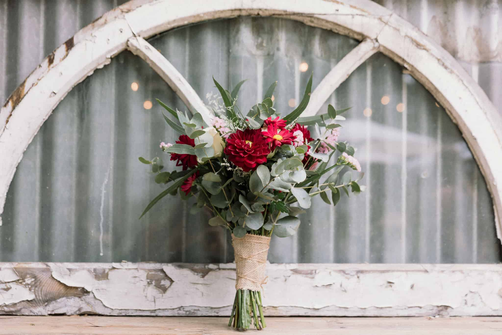 close up of bridal bouquet deep reds and greens Captured by James White Hunter Valley Wedding Photographer