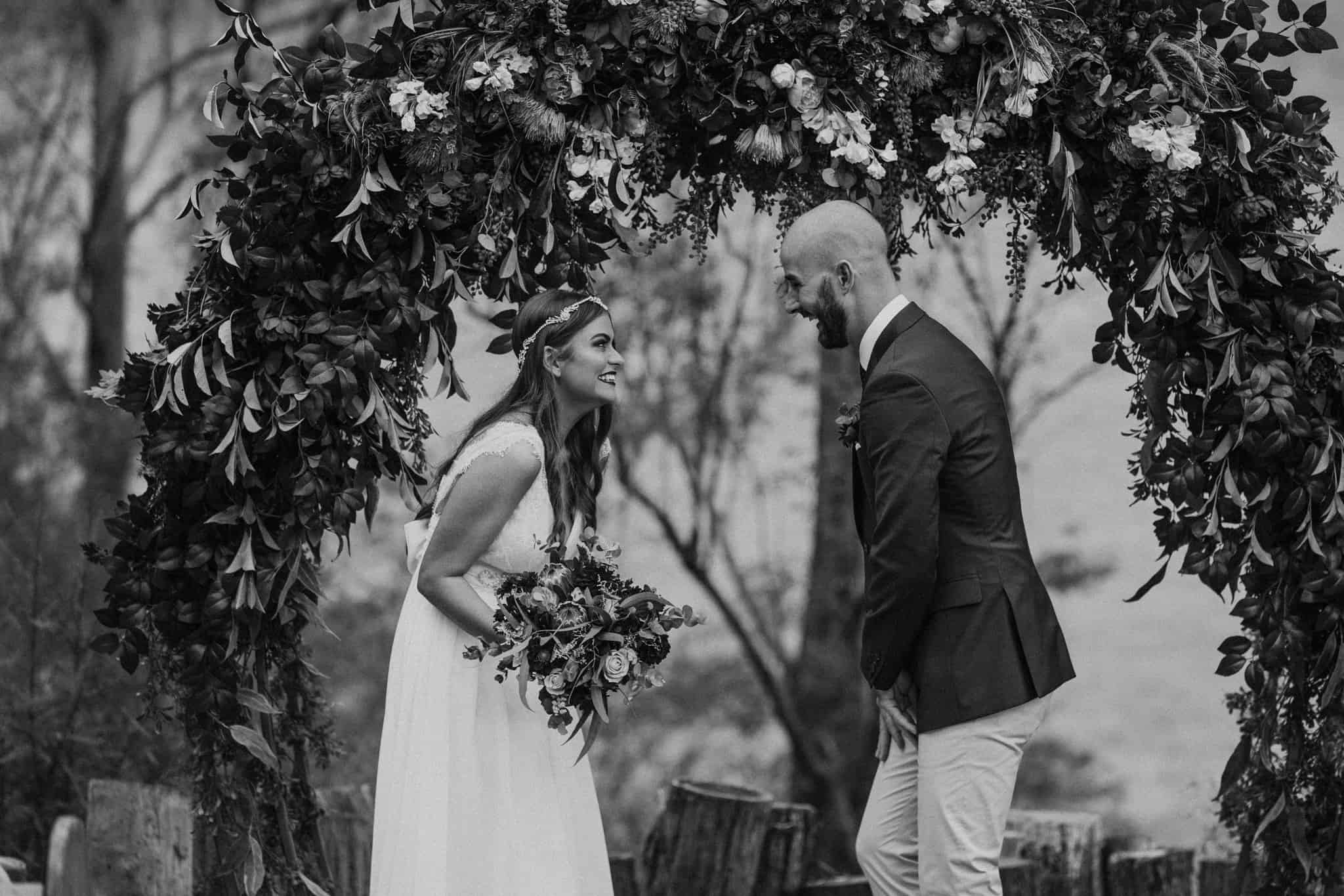 Bride and groom both laughing during ceremony Captured by James White Hunter Valley Wedding Photographer