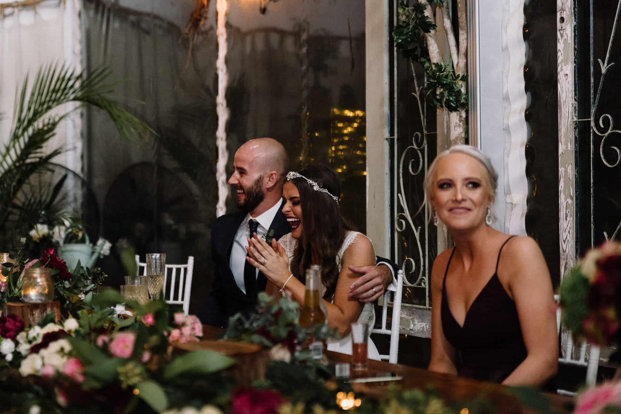 Bride laughing during speeches Captured by James White Hunter Valley Wedding Photographer