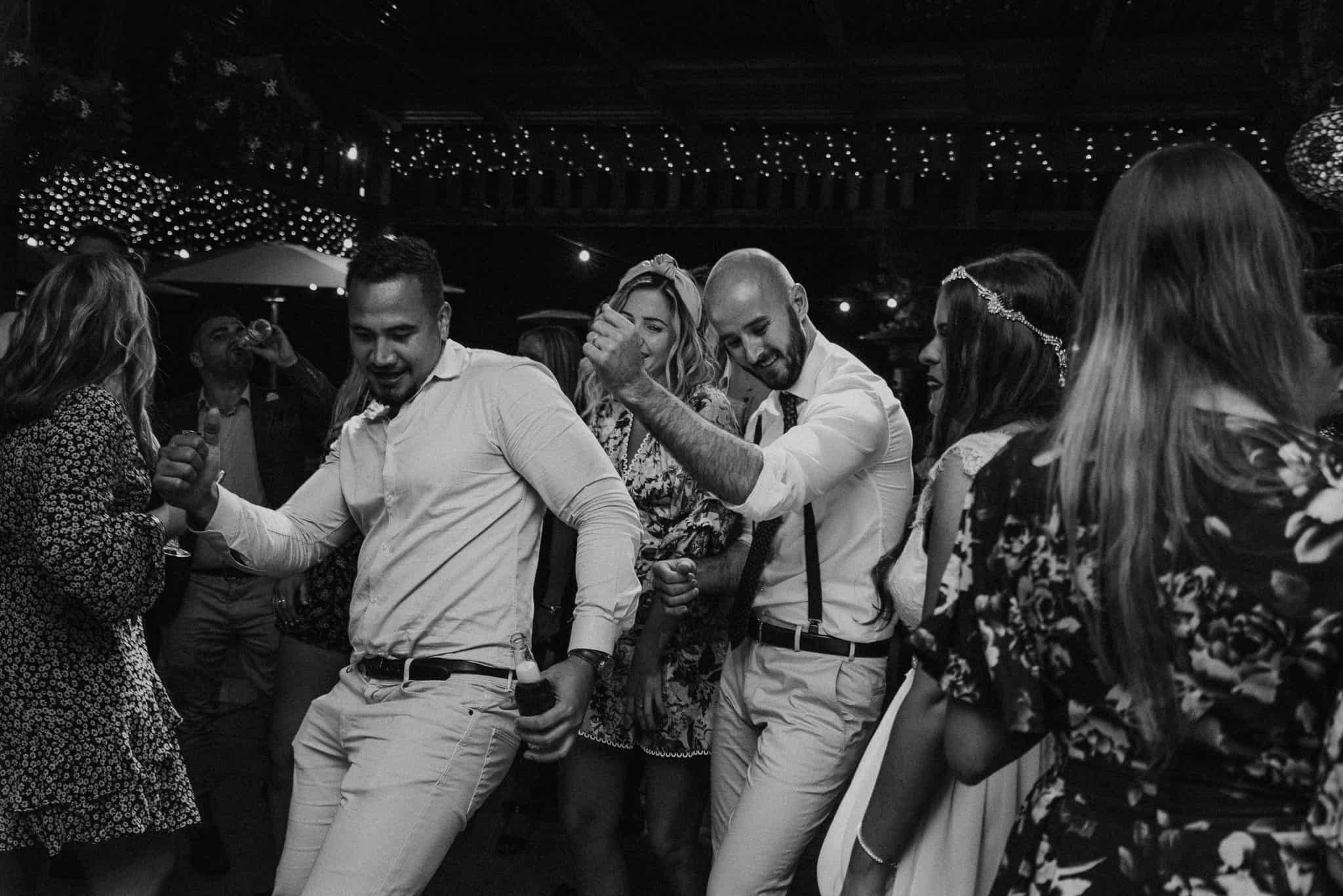 Newlyweds and friends boogie on the dancefloor Captured by James White Hunter Valley Wedding Photographer
