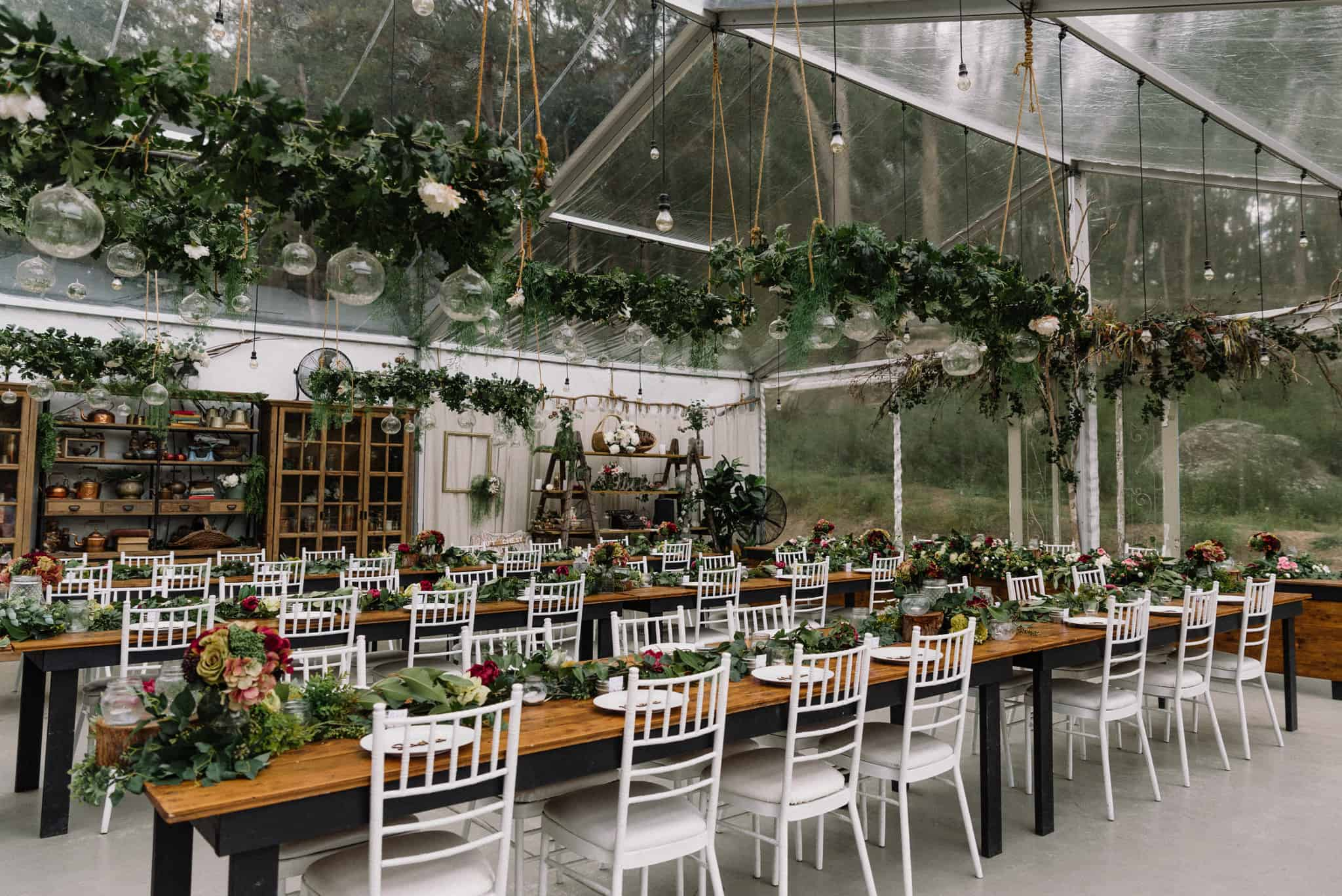 Rustic boho marquee reception with hanging floral installation and garlands Captured by James White Hunter Valley Wedding Photographer