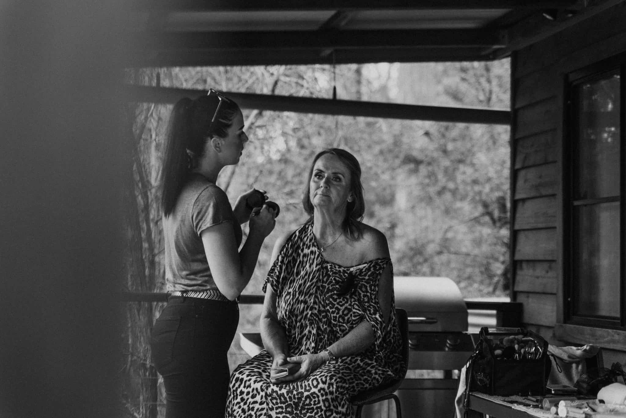 Mother of the bride gets makeup done Captured by James White Hunter Valley Wedding Photographer