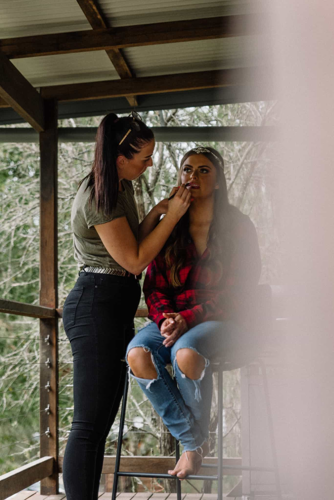 Bride getting makeup done lips touched up Captured by James White Hunter Valley Wedding Photographer