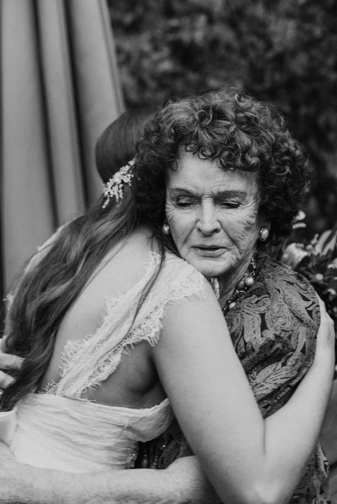 Bride embraces grandmother after ceremony Captured by James White Hunter Valley Wedding Photographer