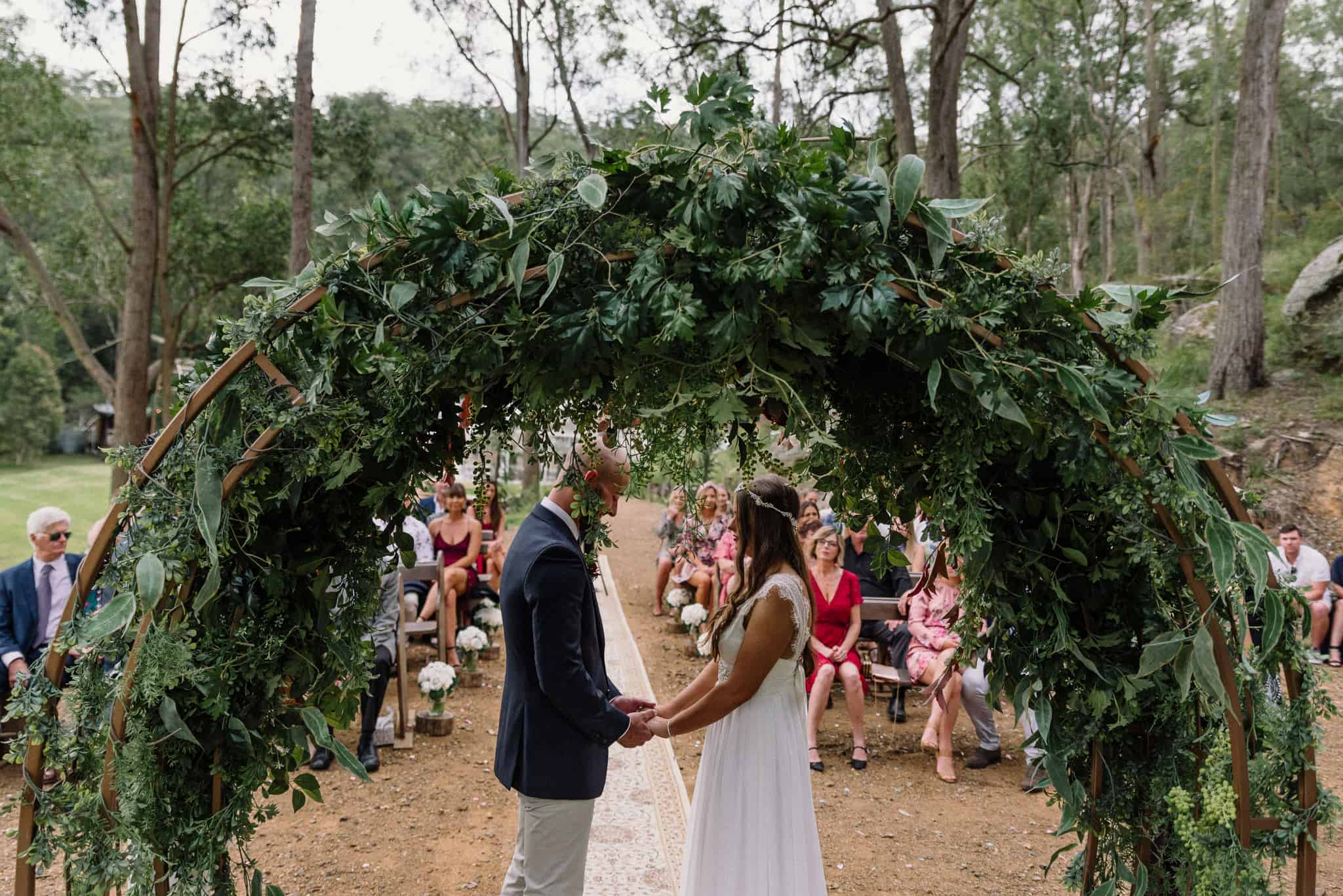 Friends and family watch as couple share vows during intimate ceremony Captured by James White Hunter Valley Wedding Photographer
