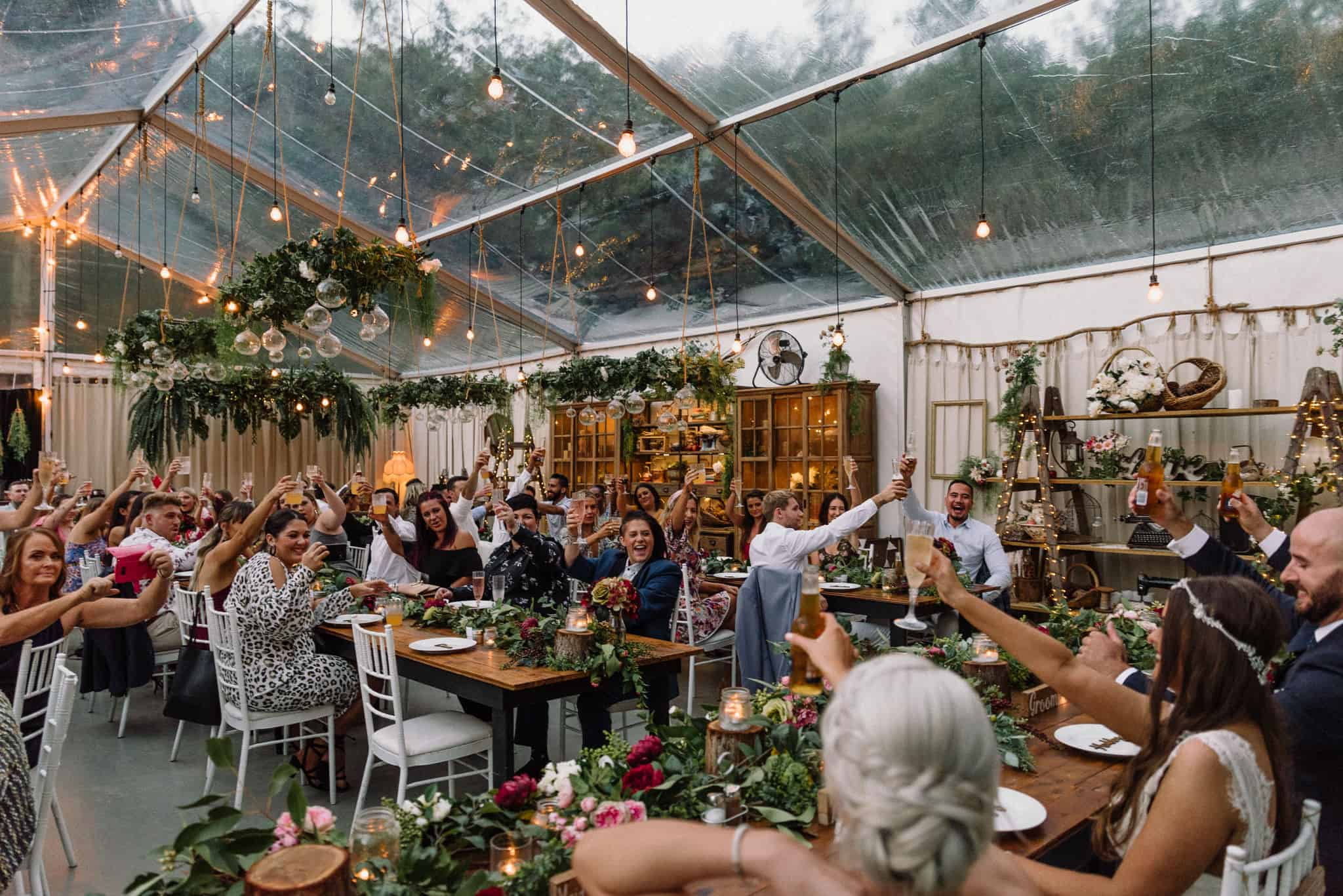 Friends and family toast to happy couple during rustic boho reception Captured by James White Hunter Valley Wedding Photographer