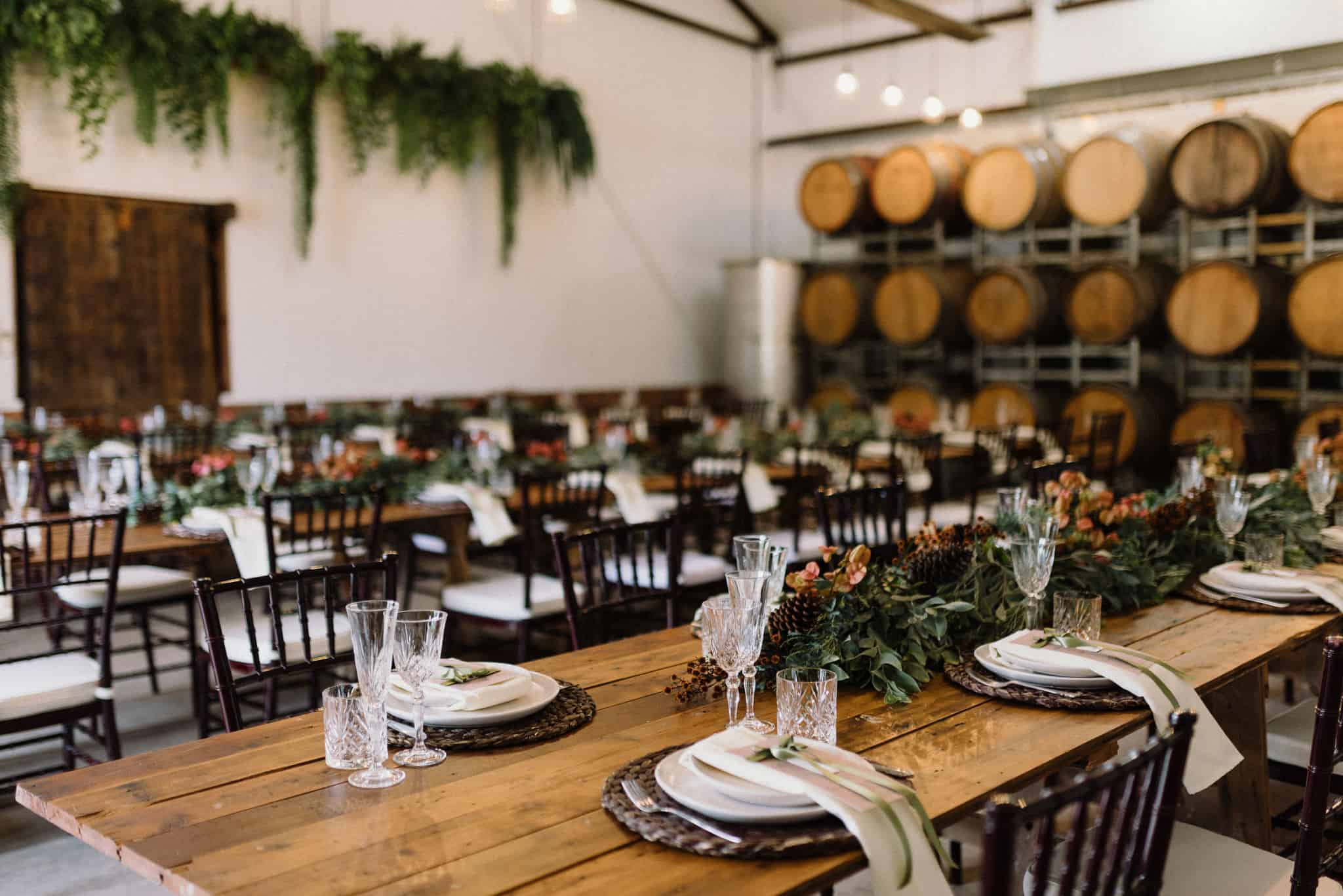 Stonehurst cedar creek venue beautiful reception hall with wooden tables and greenery captured by james white hunter valley wedding photographer