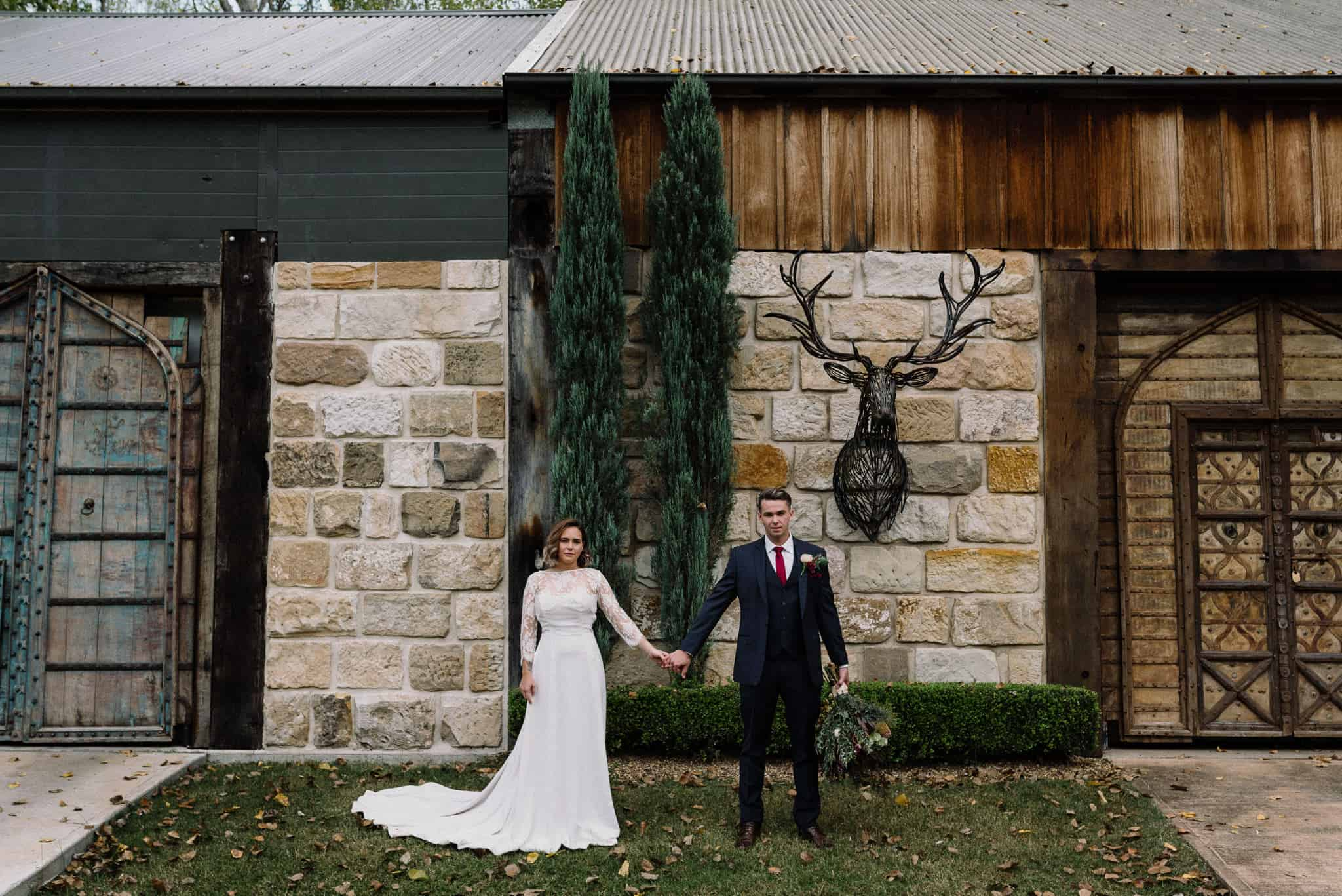 iconic stonehurst cedar creek shot out bride and groom out front of old sandstone wine cellar james white hunter valley wedding photographer