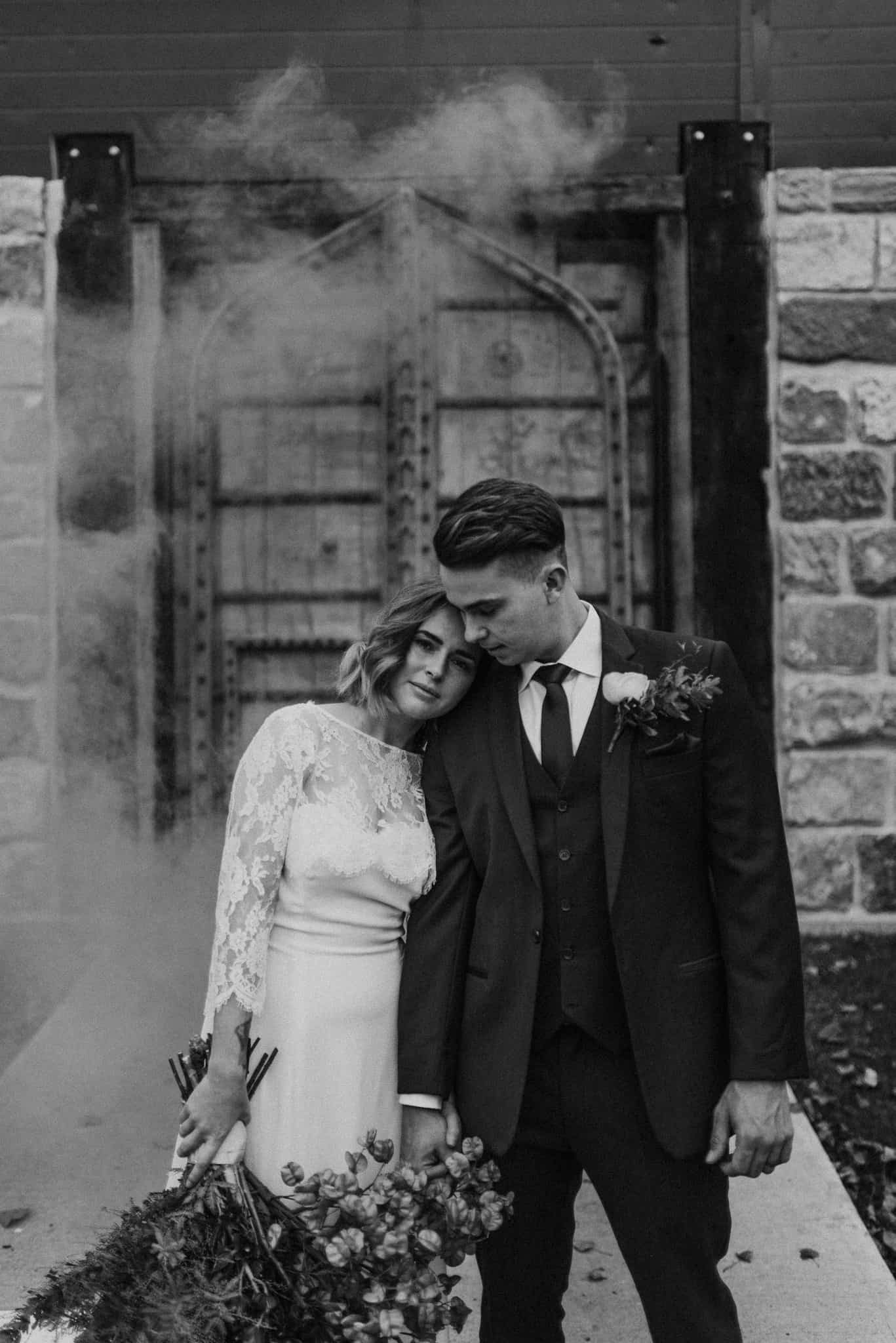 bride leans in on groom at stonehurst cedar creek during portrait session james white hunter valley wedding photographer