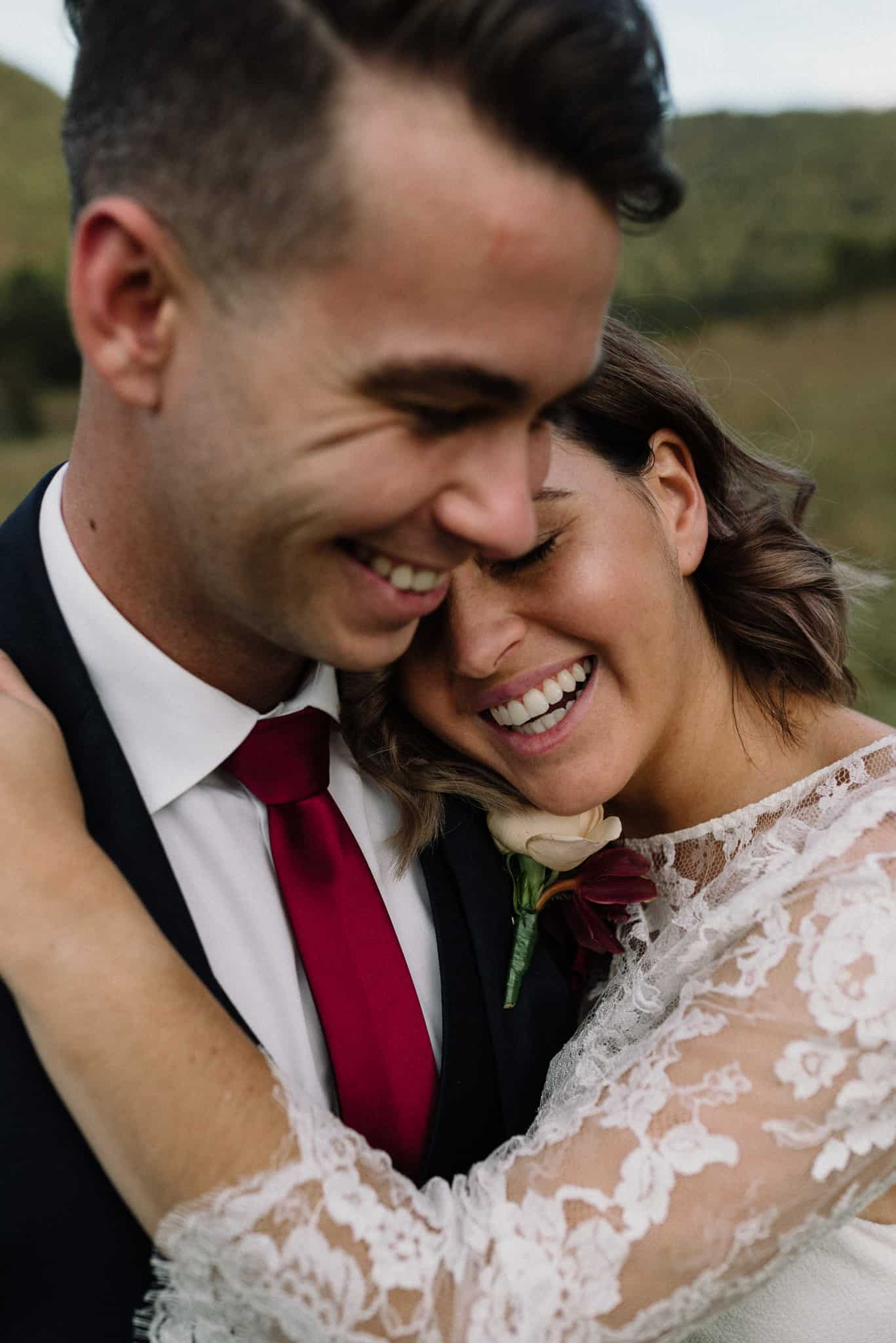 bride and groom laughing as they hug at stonehurst cedar creek wedding james white hunter valley wedding photographer