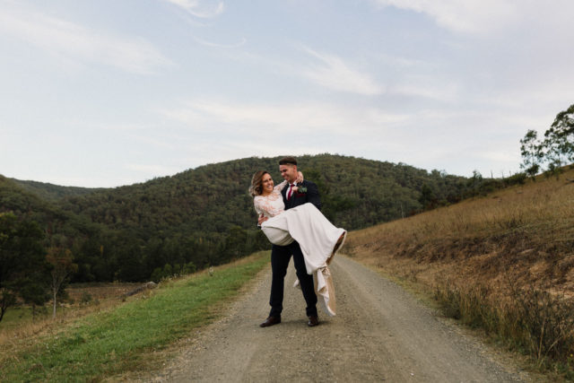 groom picks up bride and spins her around at stonehurst hunter valley wedding venues favourites