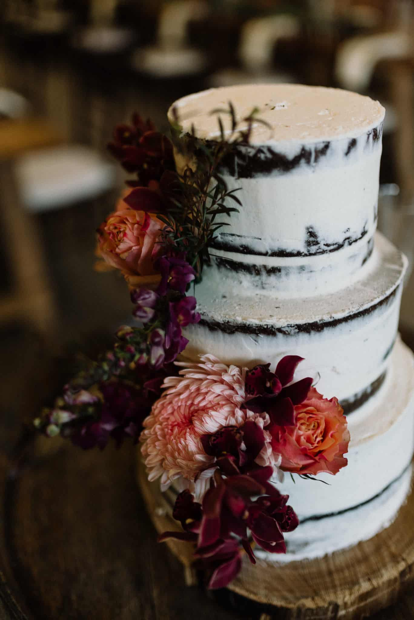 stnning semi naked wedding cake on wine barrel in reception barn at stonehurst cedar creek james white hunter valley wedding photographer