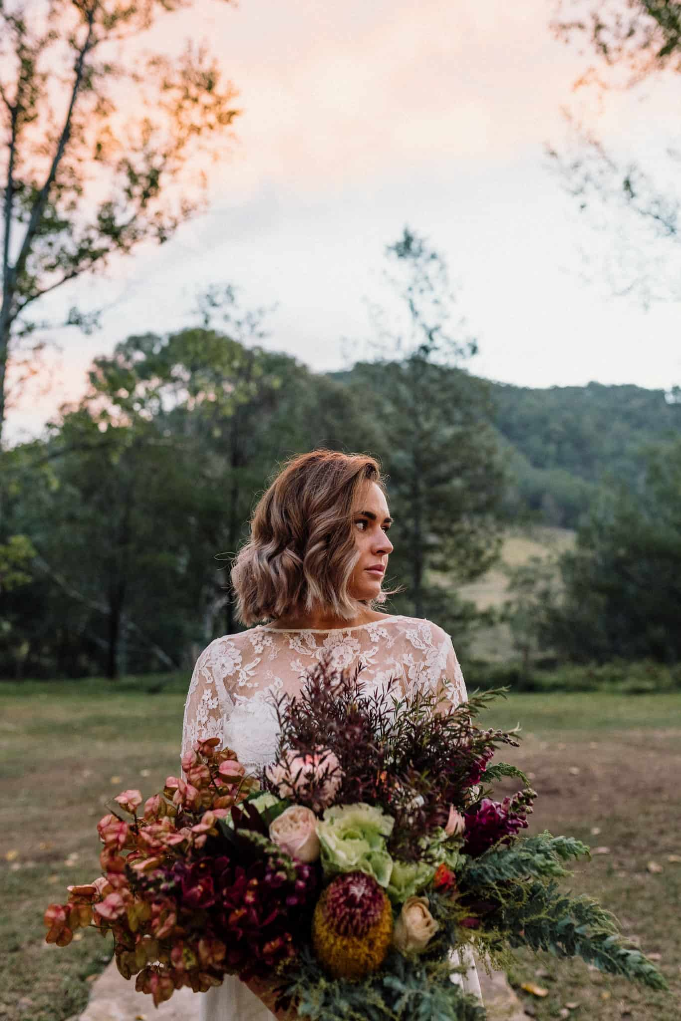beautiful colours of the bridal bouquet match the colours of the sky at stonehurst cedar creek james white hunter valley wedding photographer