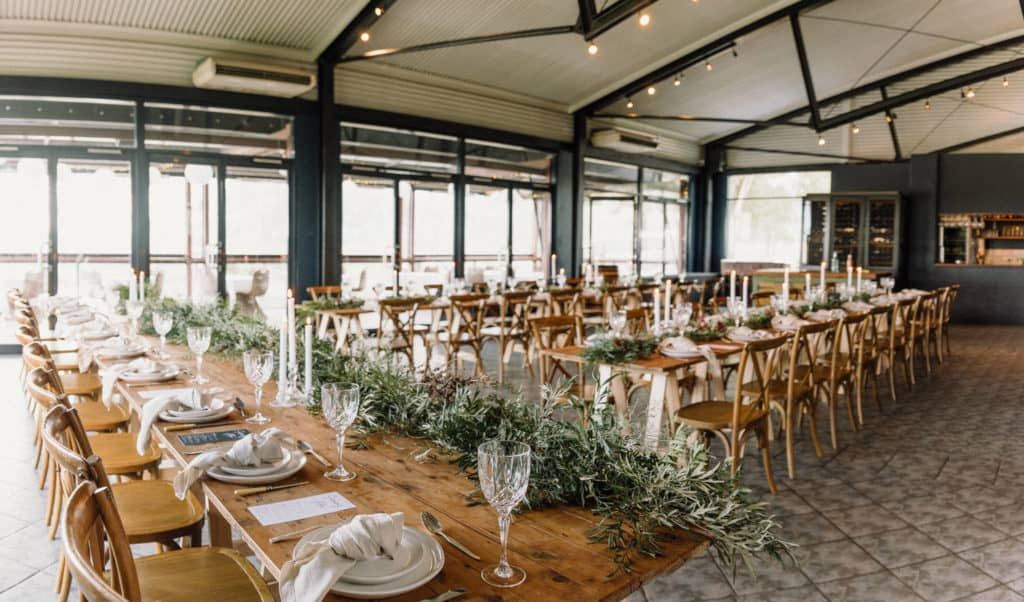 long wooden table setup, covered in natural green runner at estate tucany captured by james white hunter valley wedding photographer