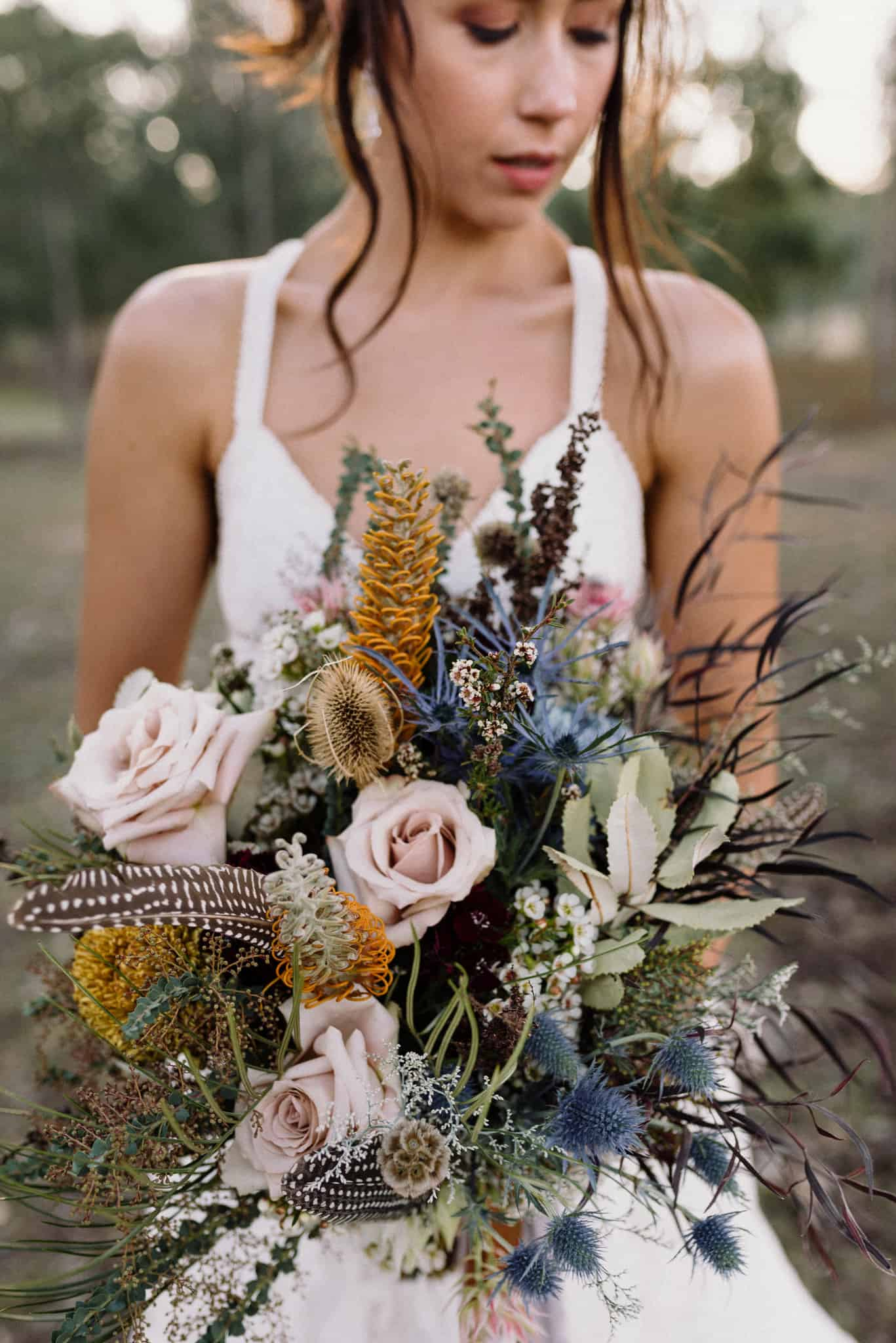 Bride holding boho floral bouquet in the grounds of Estate Tuscany Captured by James White Hunter Valley Wedding Photographer
