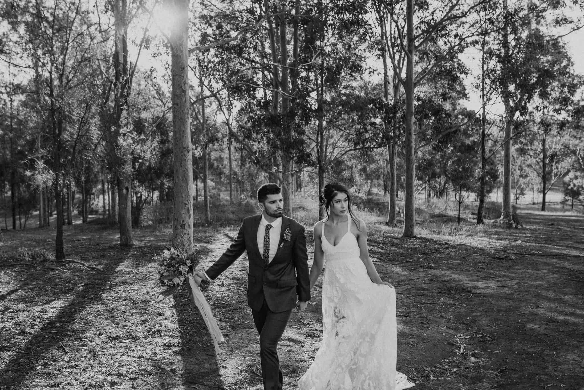 Newlyweds walking around the grounds of Estate Tuscany during sunset Captured by James White Hunter Valley Wedding Photographer