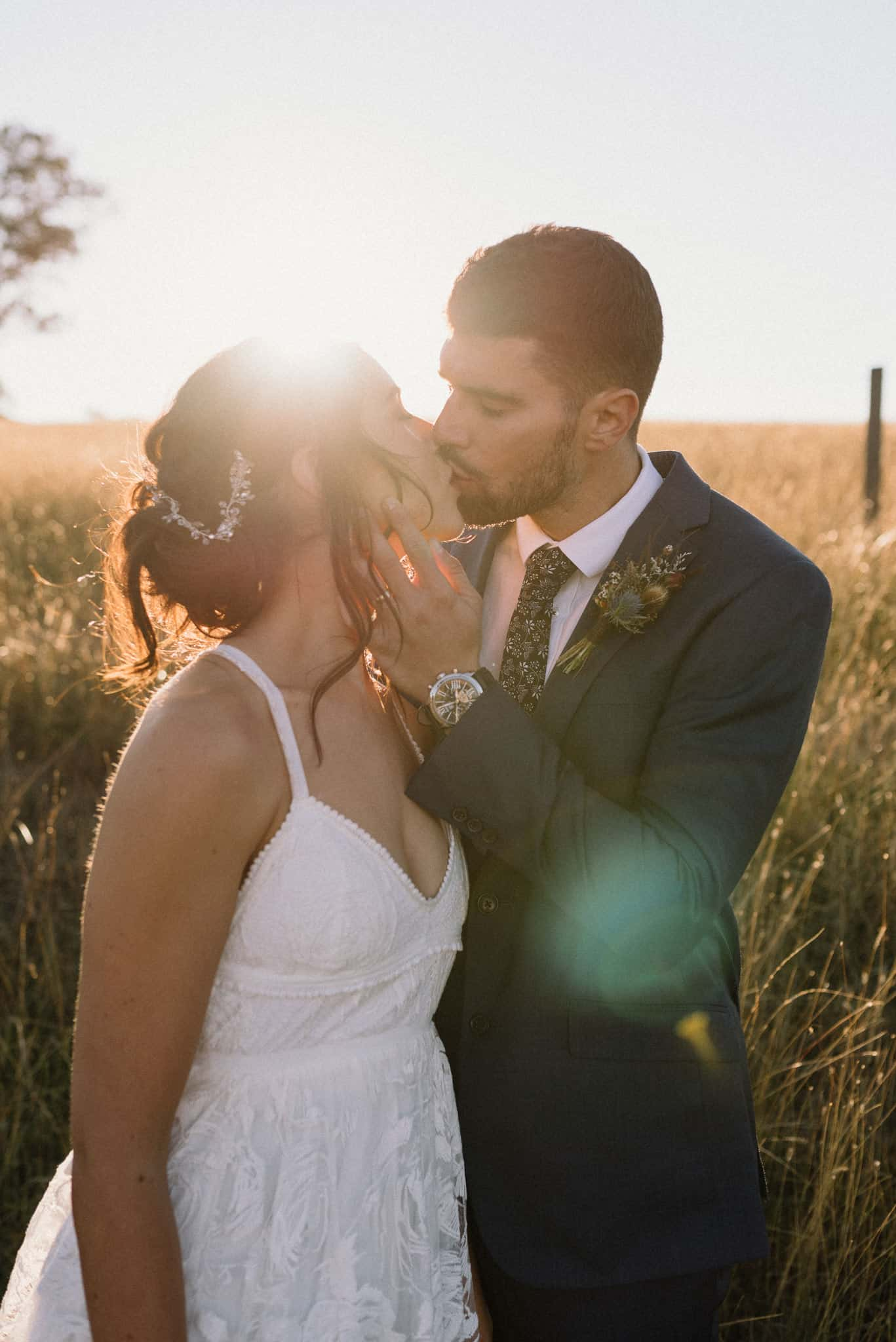 Newlyweds kiss outside venue at Estate Tuscany with sun burst Captured by James White Hunter Valley Wedding Photographer