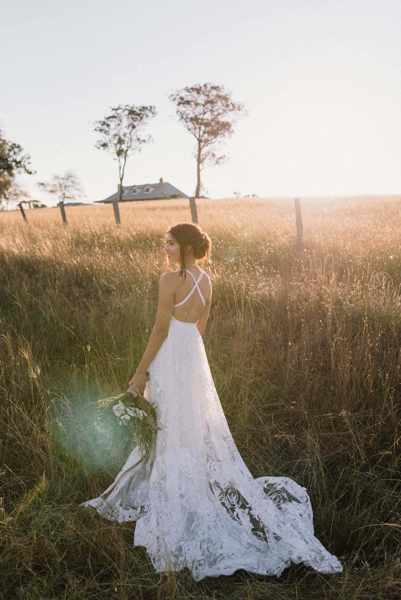 Bride smiles during portrait session at Estate Tuscany during golden hour Captured by James White Hunter Valley Wedding Photographer
