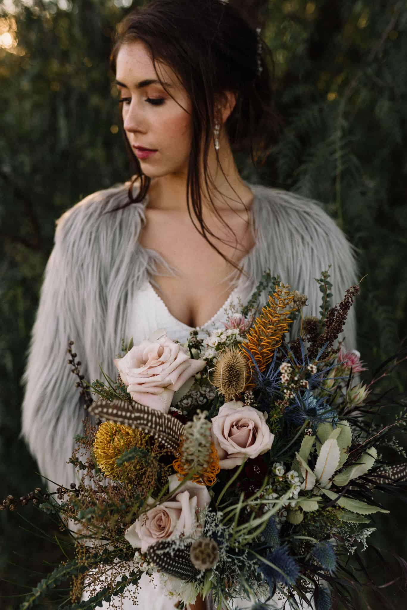 bride with stunning colourful bouquet at wedding shoot