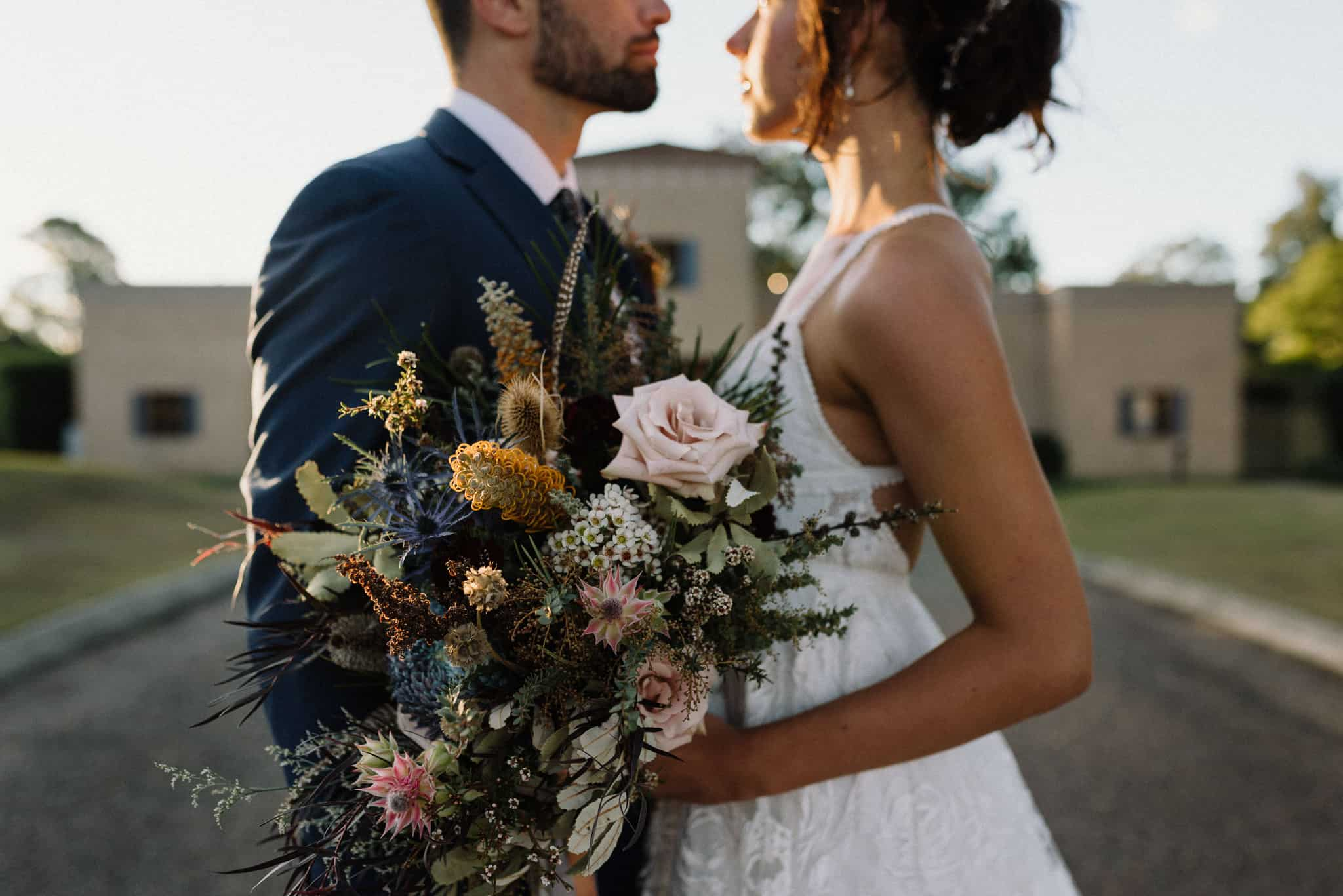 Close up of bridal bouquet with Estate Tuscany in the background Captured by James White Hunter Valley Wedding Photographer