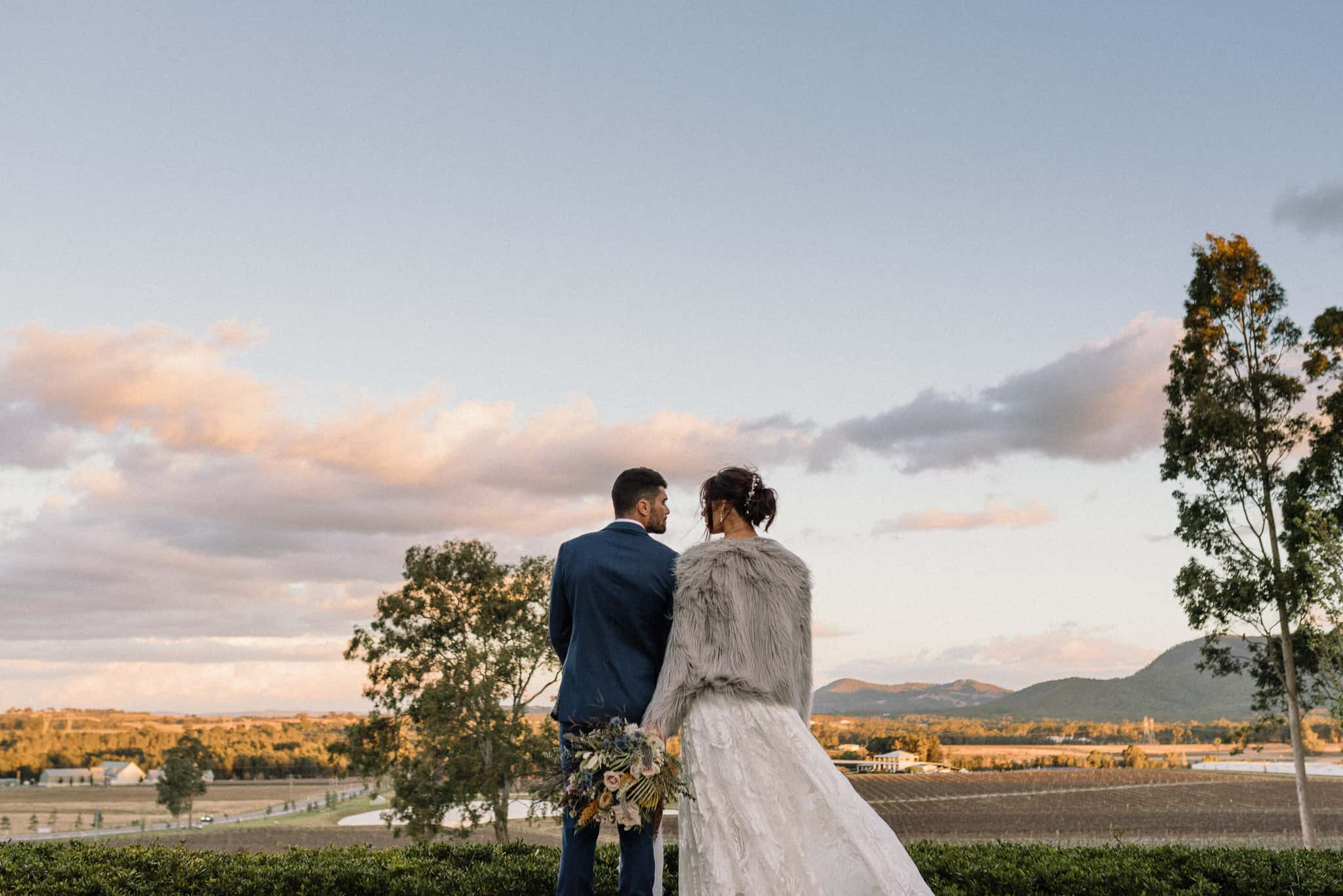 Bride and groom look out at Estate Tuscany Vineyards Captured by James White Hunter Valley Wedding Photographer