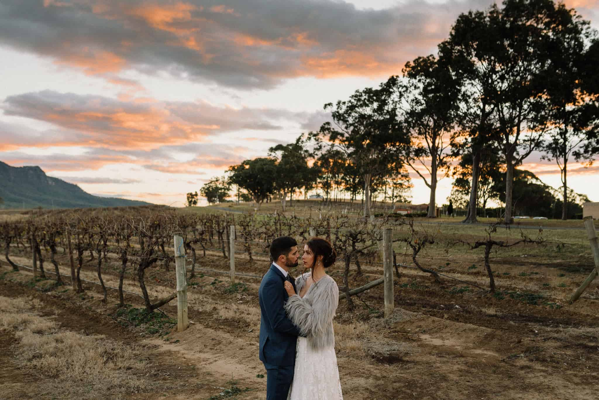 Newlyweds in the vineyards at Estate Tuscany as sun goes down Captured by James White Hunter Valley Wedding Photographer