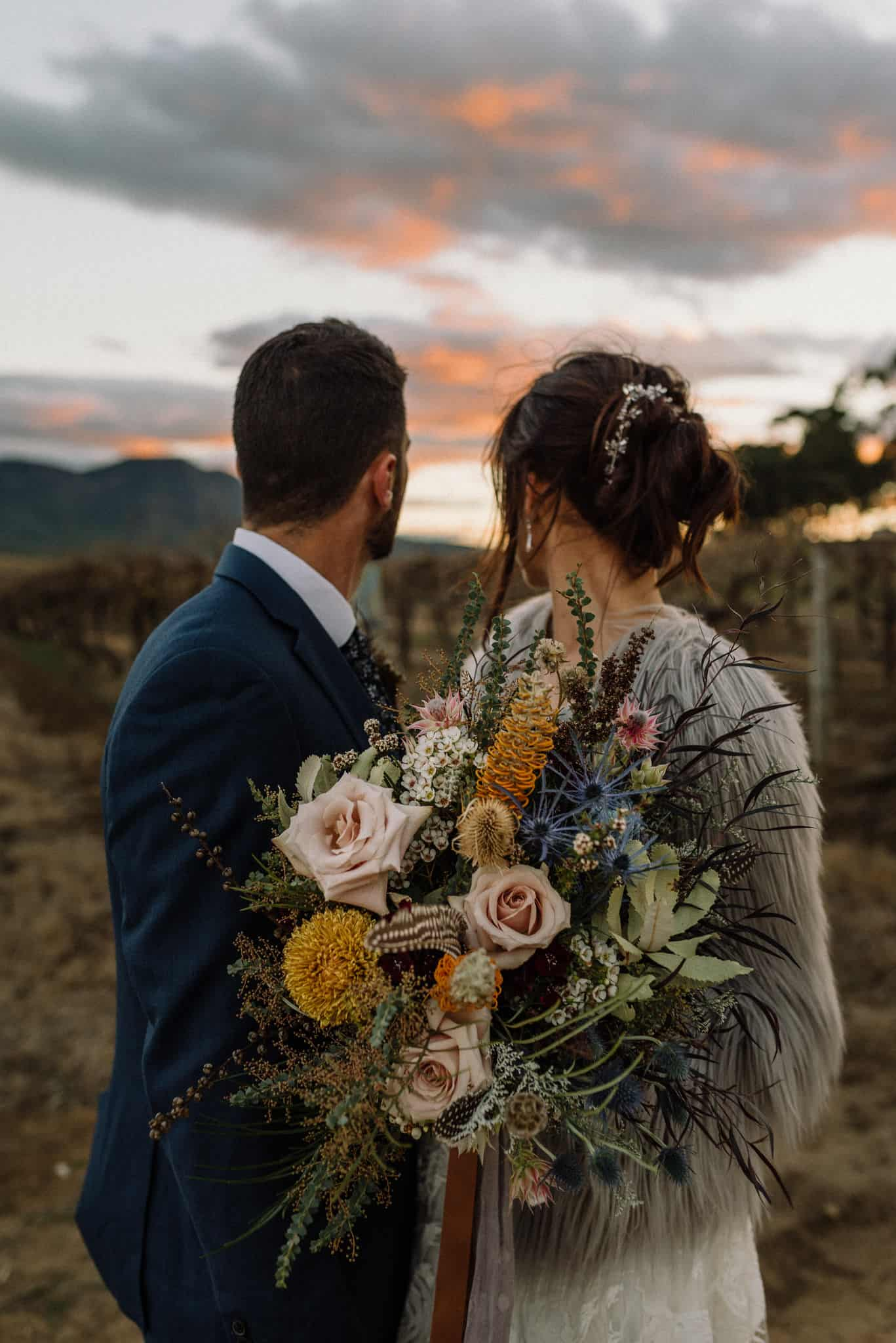 Bride and groom look out at sunset over Estate Tuscany Captured by James White Hunter Valley Wedding Photographer