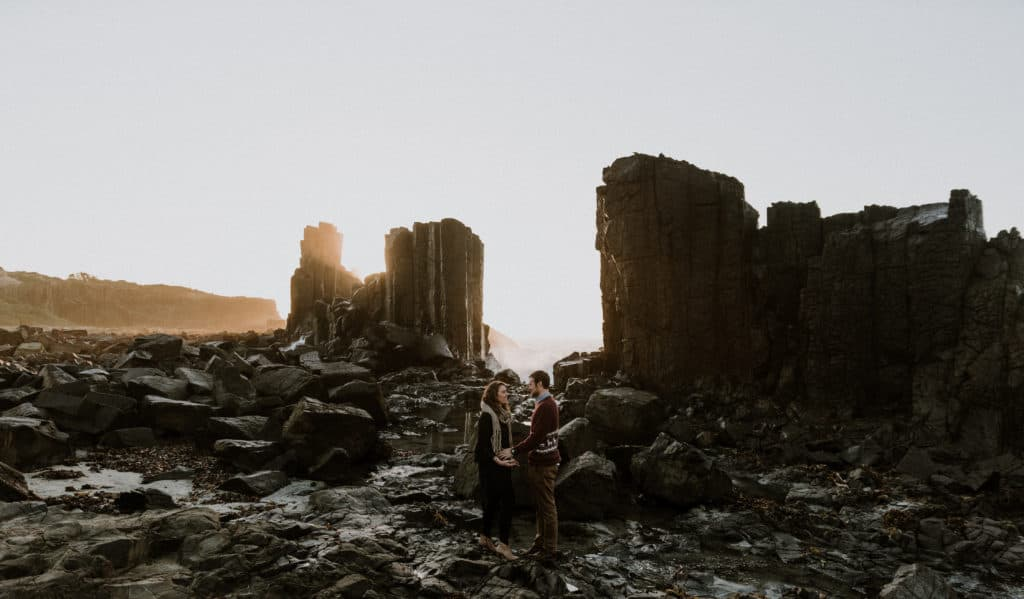 Unbelievable black granite rock formation, very similar to Norway or Iceland elopements as bride and groom elope at sunrise in Australia