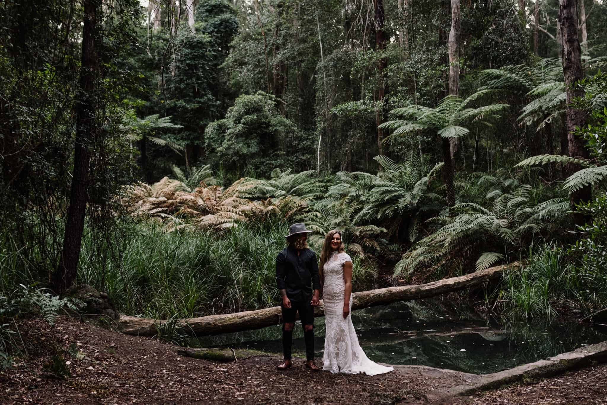 Bride and groom enjoy gorgeous lighting for their pine forest photos after following wedding day timeline