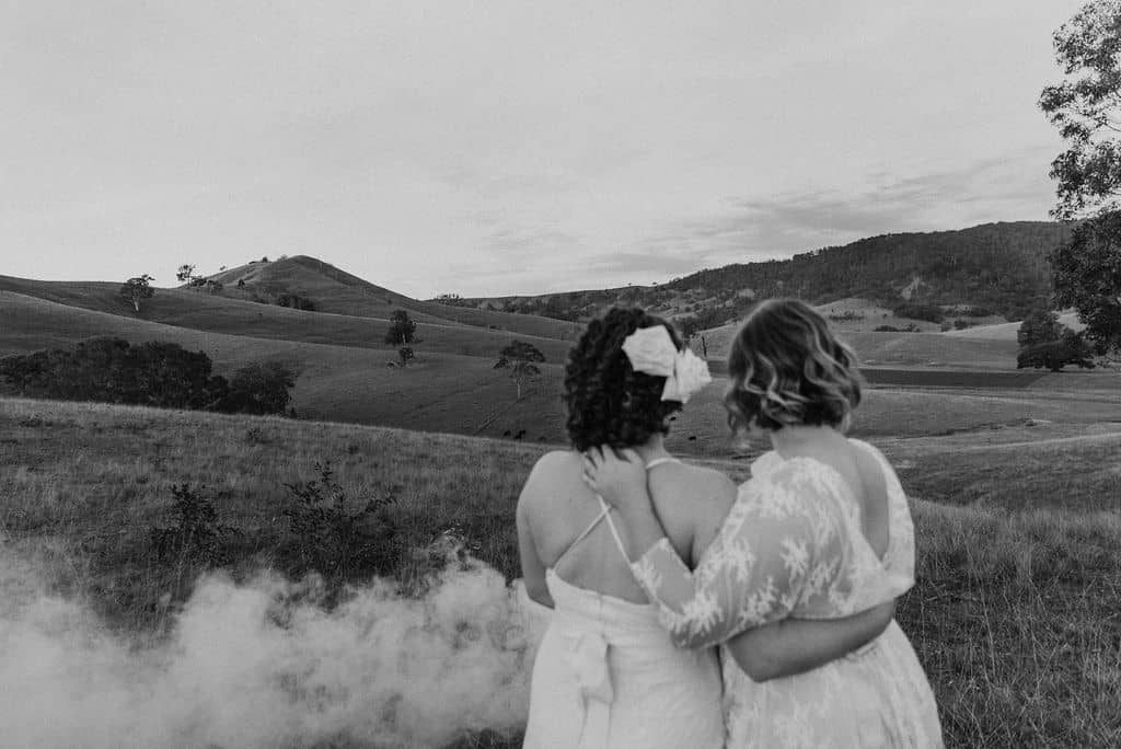 beautiful brides overlooking rolling mountains as they have their elopement ceremony