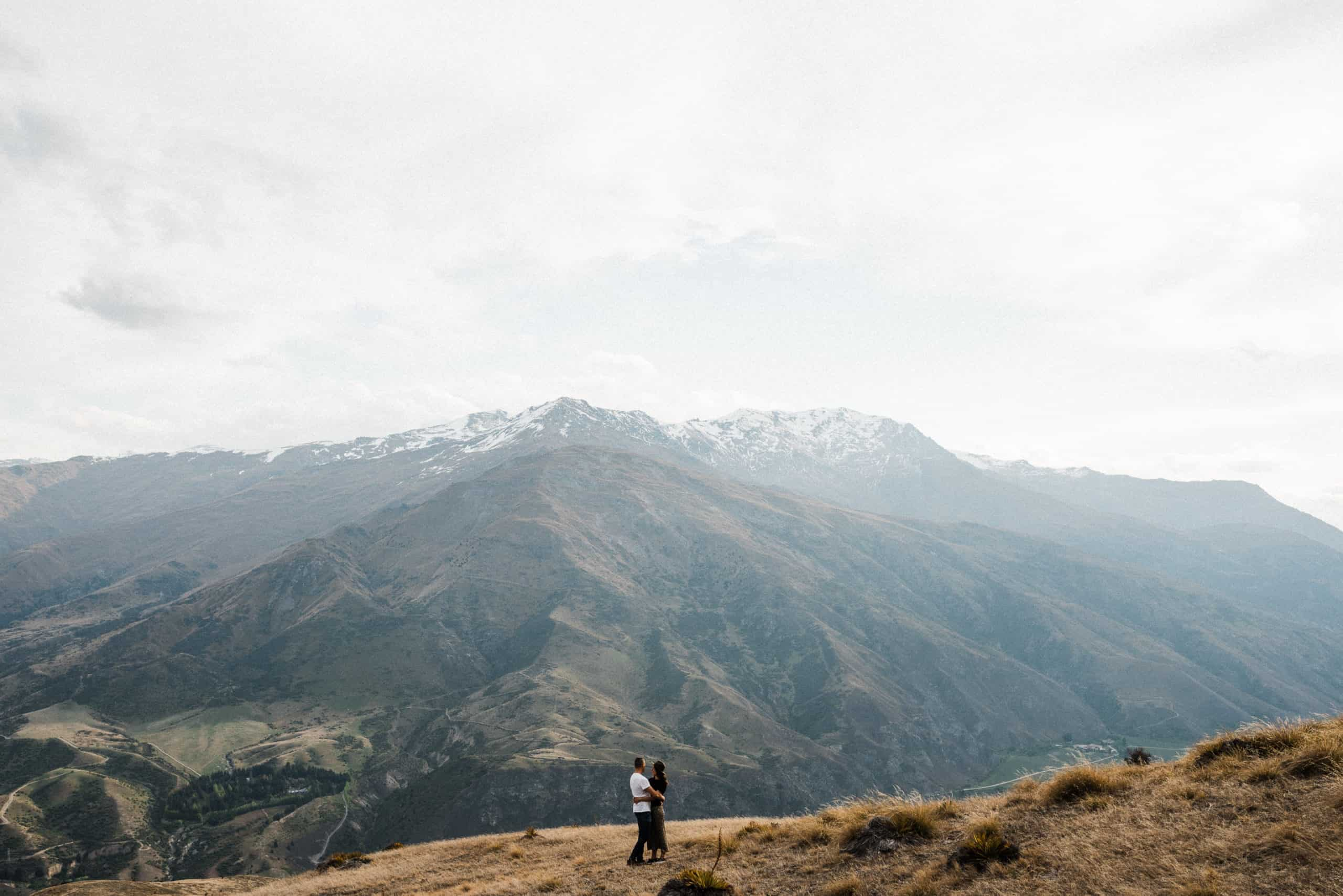 bride and groom in casual clothing elope on mountain in wanaka new zealand