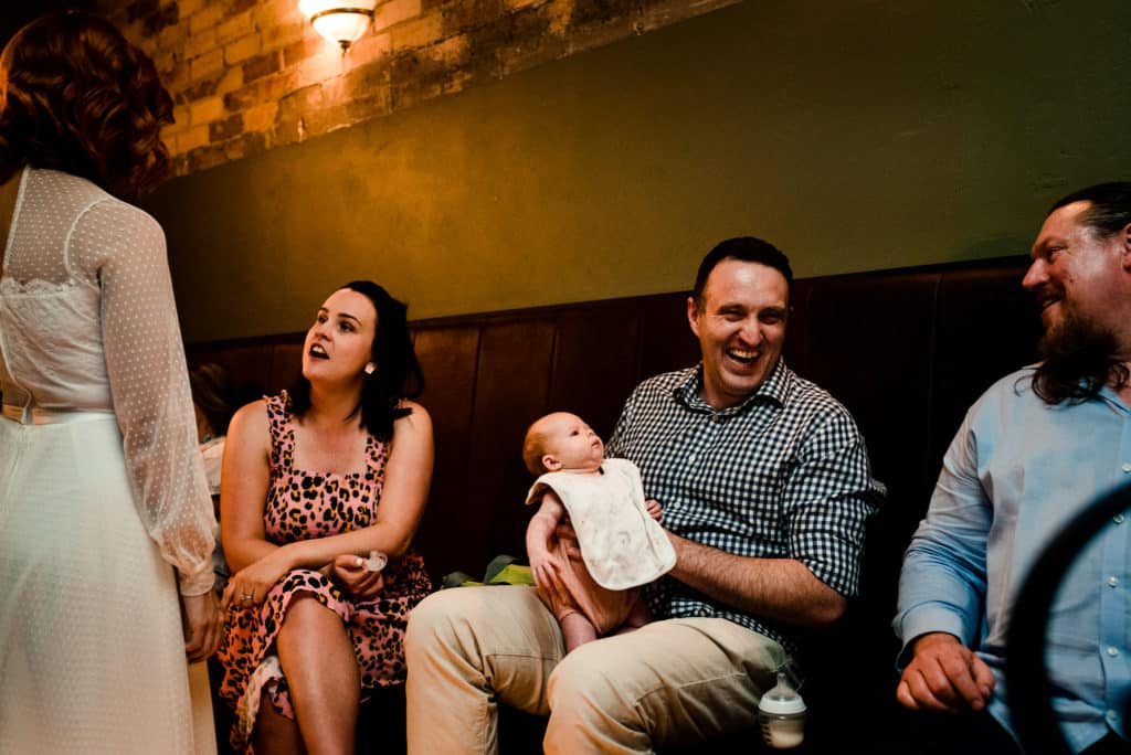 guests enjoying reception with cute baby savoy long jetty wedding