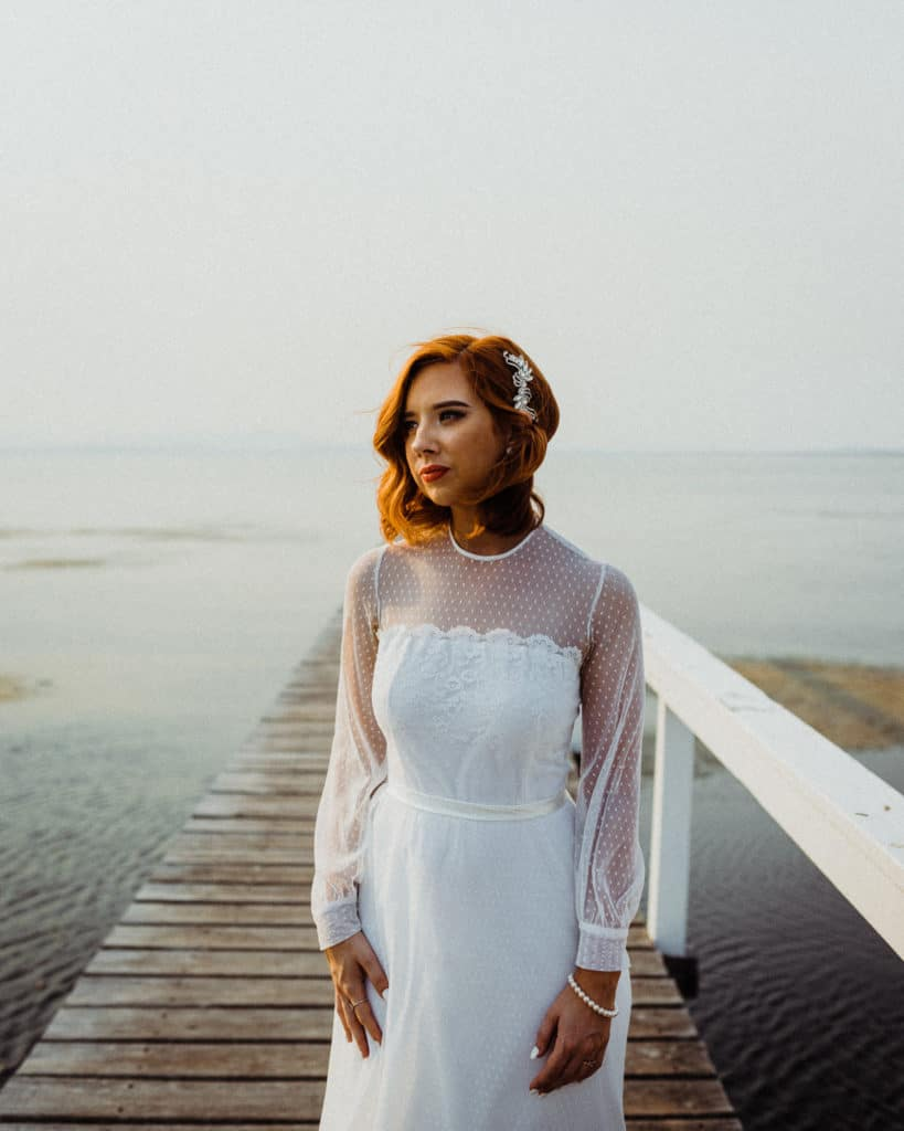 bride looking stunning on the lake at the savoy long jetty wedding