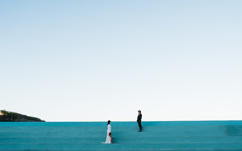 bride and groom stand on steps at Newcastle baths