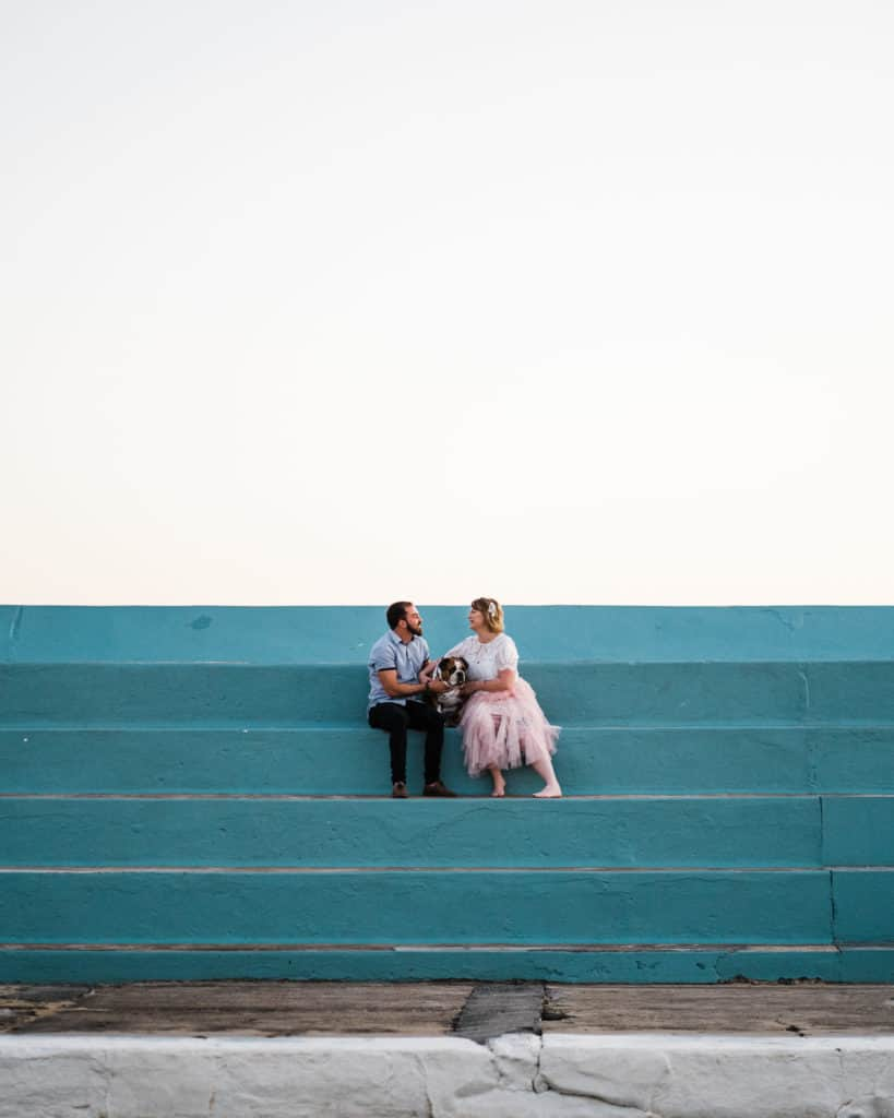 bride and groom pose for sunrise photos at newcastle baths captured by james white newcastle wedding photographer