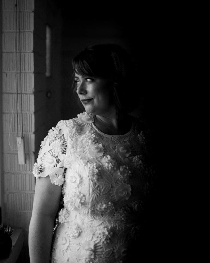 beautiful elegant shot of bride in front of window before wedding ceremony captured by james white newcastle wedding photographer